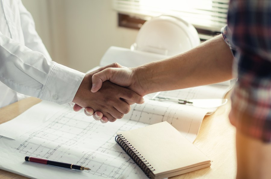 Remodeling Contractor shaking hands with a client