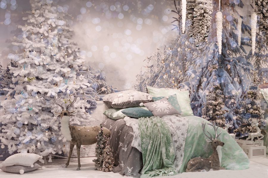 Cozy bedroom interior decorated with Christmas details JC Design
